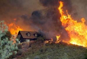 wildfire surrounding home